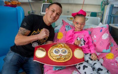 Local boxing champ lauds fighting spirit with charity donation